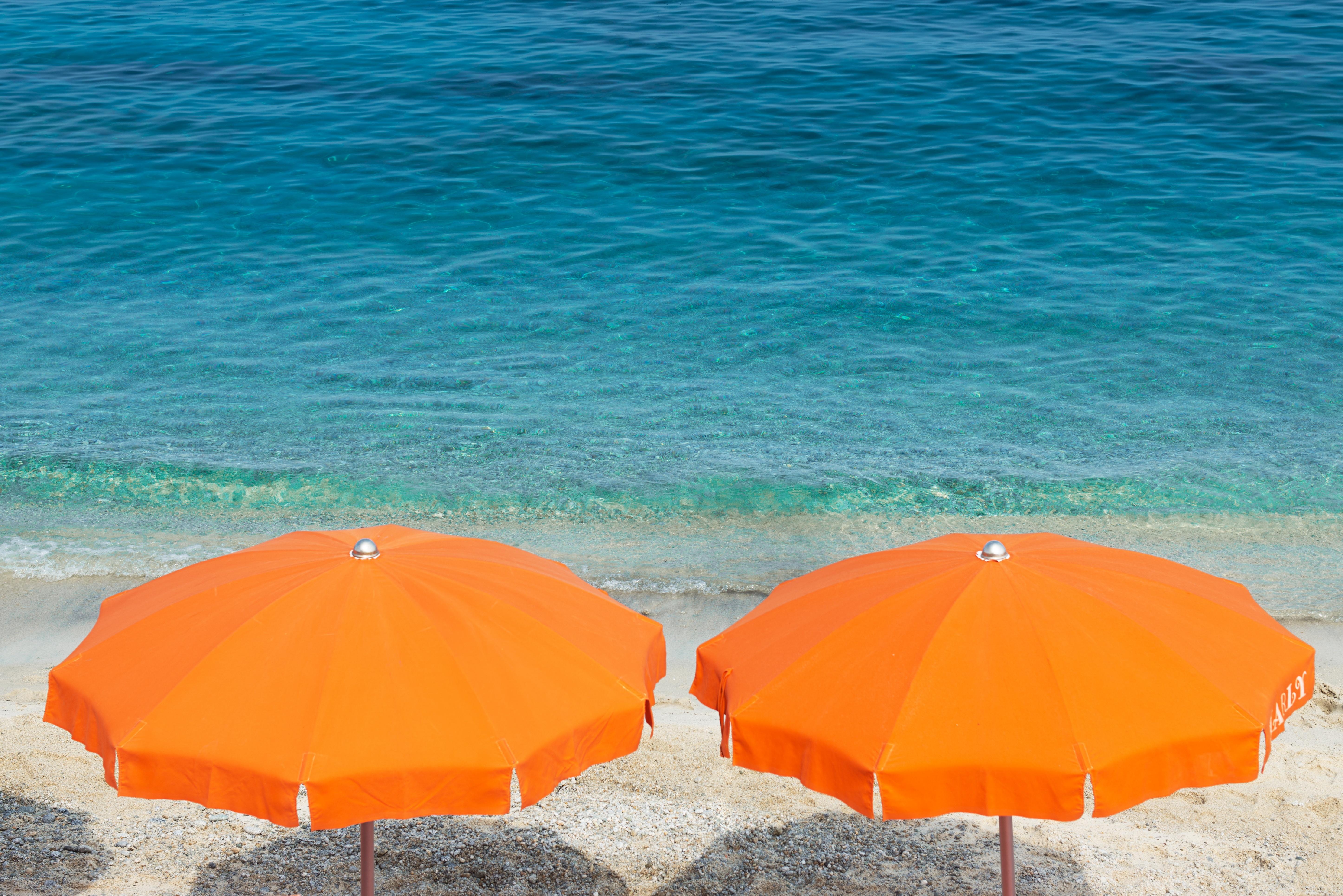 Big two orange parasol on the beach.